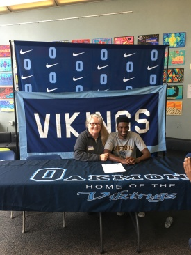 A recruit celebrates his commitment to UCSC Track & Field